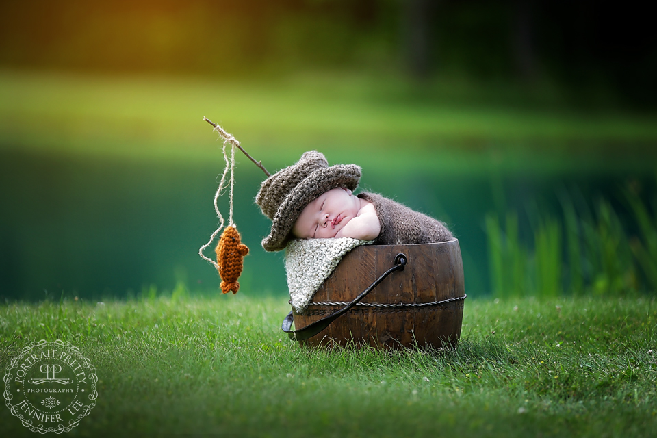 newborn boy outside fishing bucket web