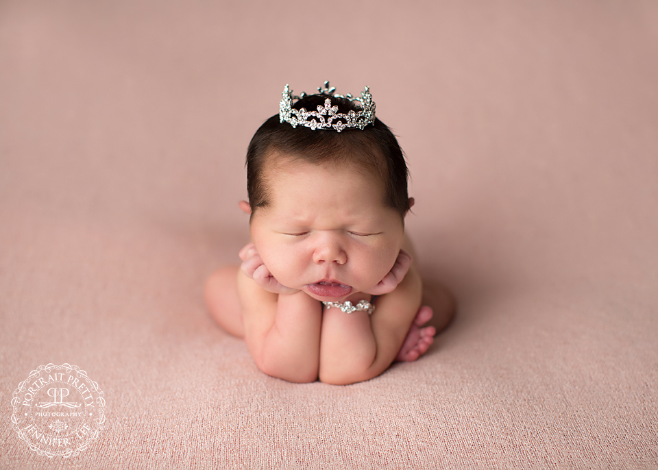 newborn girl head in hands crystal crown buffalo ny