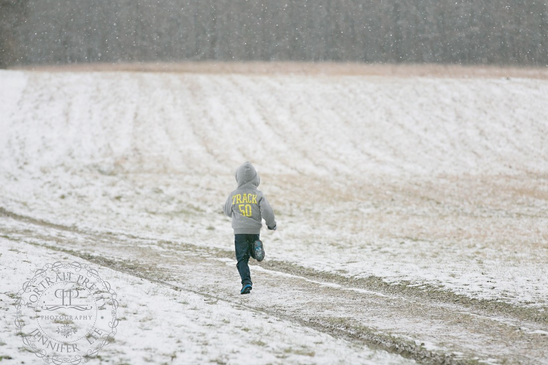 boy running snow portrait