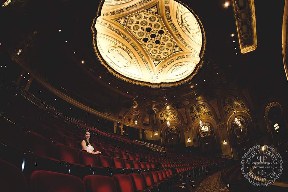 Sheas senior portraits on the seats in the theater gold ceiling by portrait pretty photography