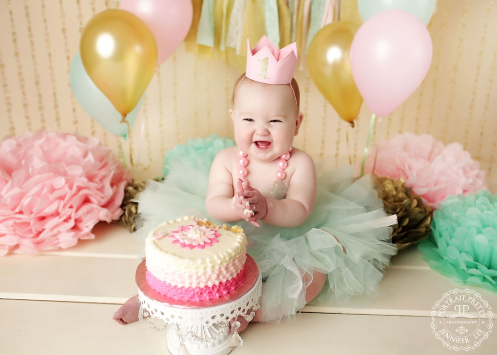 pink mint and gold first birthday cake smash portraits by portrait pretty photography