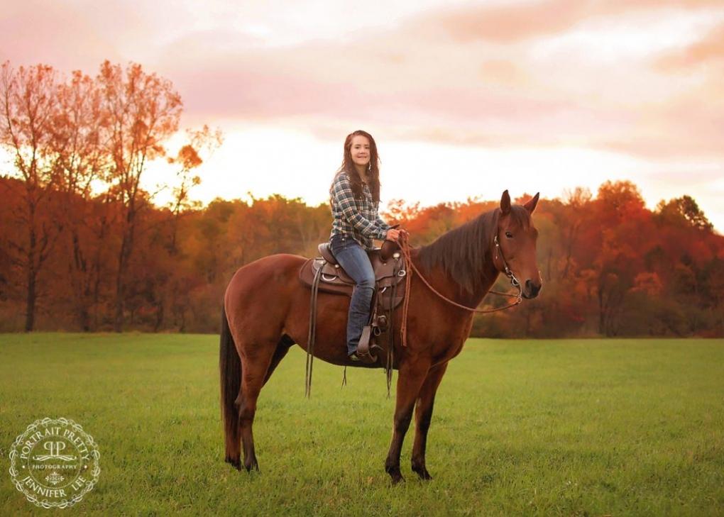 autumn sunrise high school senior portraits with horse buffalo photographers portrait pretty photography