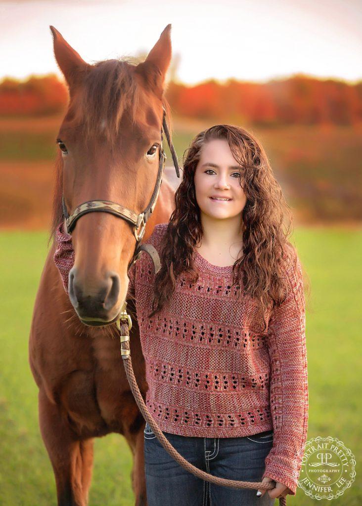 cowgirl senior portraits with horse buffalo photographers portrait pretty photography