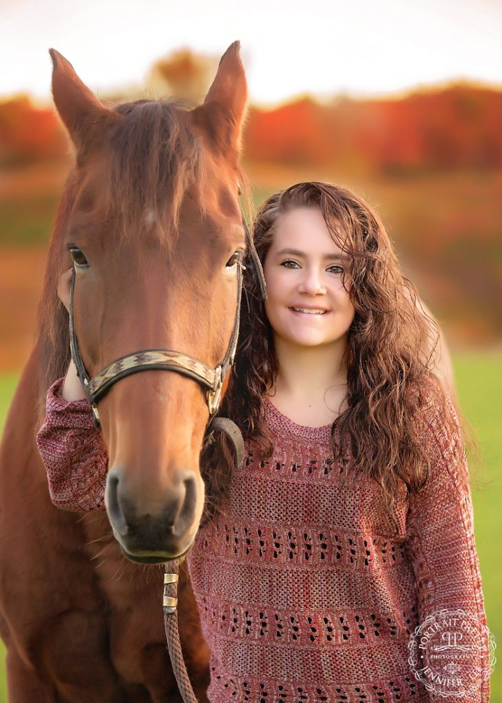equestrian senior portraits with brown horse buffalo photographers portrait pretty photography