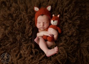 newborn-baby-in-fox-hat-in-buffalo-ny-photographer