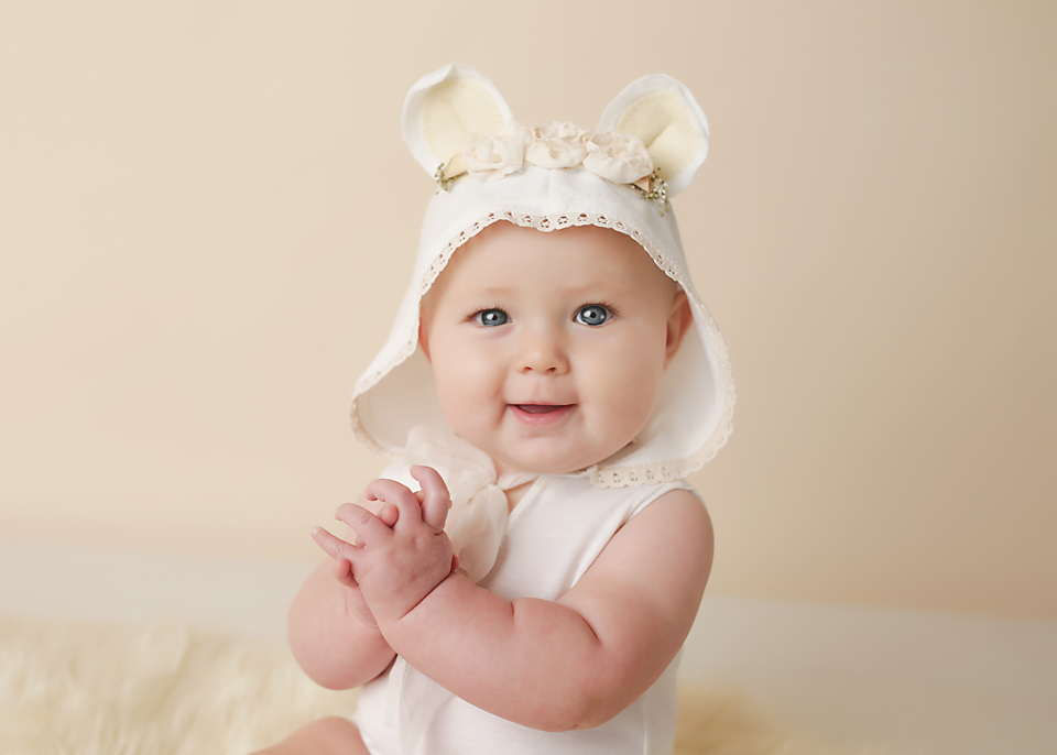 baby in bear romper portrait pretty photography